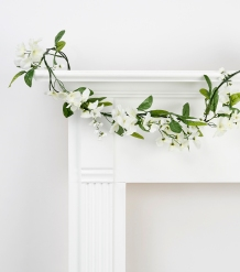 Example of plastic garland with white flowers, found at Joann's Fabrics